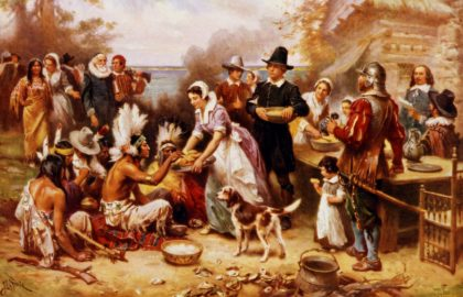 The first Thanksgiving 1621 by Jean Leon Gerome Ferris, 1863-1930, artist. Published by the Foundation Press, Inc., c1932. photomechanical print halftone, colour. Pilgrims and Natives gather to share meal. (Universal History Archive/UIG via Getty Images)